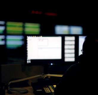 Image: Cybersecurity expert monitoring telecommunications traffic