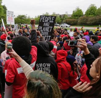 Protestors call for a $15-an-hour minimum wage as McDonald's shareholders meet at the company's corporate headquarters in Oak Brook, Ill. on Thursday, May 21, 2015.