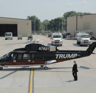 Donald Trump walks to board his private helicopter to fly to the Iowa State Fair Sunday.