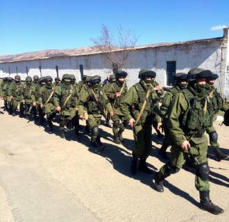 Image: Russian troops during shift change outside Privolnoye military base in Crimea, Ukraine.