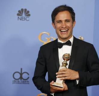 Image: Actor Gael Garcia Bernal poses backstage with the award for Best Performance by an Actor in a Television Series - Musical or Comedy for his role in