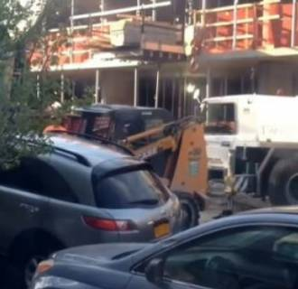Image: SUV being moved by a forklift