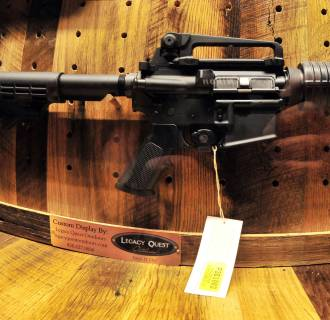 Image: An AR-15 rifle is seen at 142nd annual NRA convention on May 4, 2013