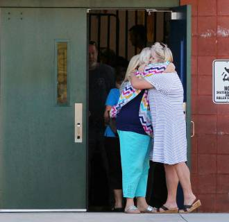 Image: Teachers hug outside Townville Elementary School