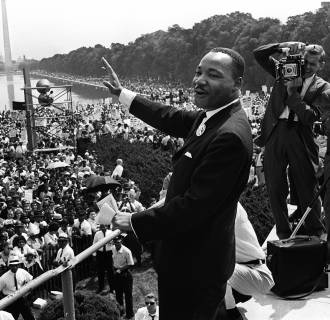 Image: The civil rights leader Martin Luther KIng waves to supporters Aug. 28, 1963 on the Mall in Washington DC (Washington Monument in background) during the