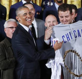 Image:  Obama is presented with personalized Chicago Cubs baseball away jersey
