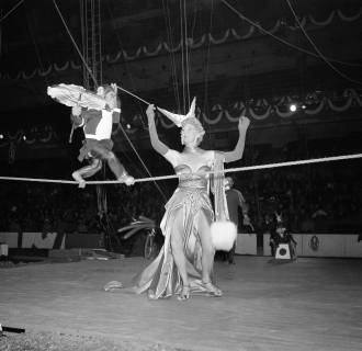 Image: Beatrice Dante puts her chimpanzee through a tight wire number in preparation for the New York opening, April 6, 1949.