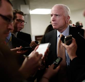Image: McCain speaks with reporters about the resignation of National Security Advisor Michael Flynn
