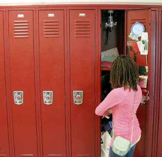 Image: A sixth grader empties her locker on June 20, 2014, the last day of class at Alice Deal Middle School in Northwest D.C.