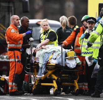 Image:  A member of the public is treated by emergency services