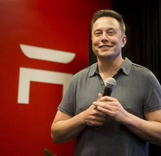 Tesla CEO Elon Musk speaks about new Autopilot features during a Tesla event in Palo Alto, California