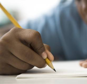 Image: A student works on classwork