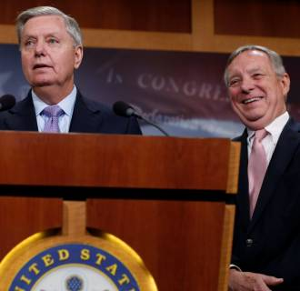 Image: Graham, with Durbin, talks about possible legislation for so-called