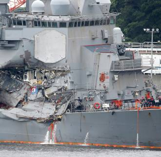Image: The Arleigh Burke-class Guided-Missile Destroyer USS Fitzgerald, Damaged by Colliding with a Philippine-flagged Merchant Vessel, is seen at the U.S. naval base in Yokosuka