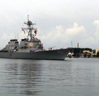 Image: The guided missile destroyer USS Benfold arrives in port in Qingdao in eastern China's Shandong Province, on Aug. 8, 2016.