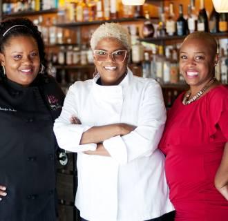 Image: Jennifer Booker, Deborah VanTrece, Tiffanie Barriere, who work at Twisted Soul, VanTrece's restaurant in Atlanta.