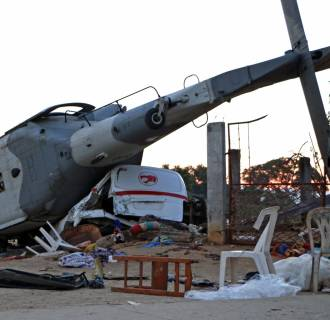 Image: The remains of the military helicopter that fell on a van in Santiago Jamiltepec, Oaxaca state, Mexico, on Feb. 17, 2018.