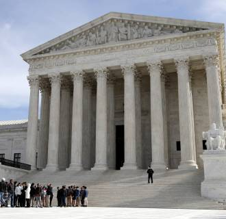 Image: People stand in line to enter the Supreme Court