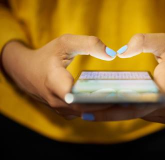 Image: Woman Typing Phone Message On Social Network At Night