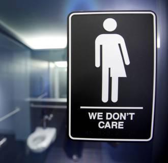 Image: A sign protesting a recent North Carolina law restricting transgender bathroom access in Durham, North Carolina.