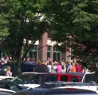 A crowd gathers outside of Noblesville West Middle School after reports of a shooting inside the building.