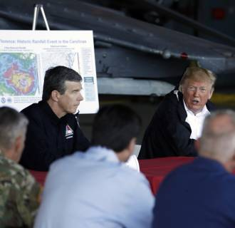 Image: Trump attends a briefing following Hurricane Florence