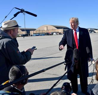 Image: U.S. President Donald Trump speaks to reporters before boarding Air Force One, as he departs from Joint Base Andrews, Maryland travelling on a 3-day trip to hold campaign rallies in Montana, Arizona and Nevada.