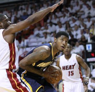 Image: Heat's Wade defends as Indiana Pacers' George eyes the basket in the first quarter during Game 2 of their NBA Eastern Conference second round basketball playoff series