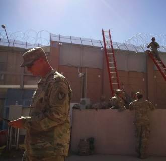 Troops use concertina wire to reinforce the Deconcini Crossing in Nogales, Arizona.