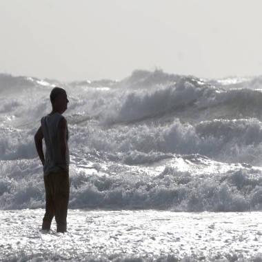 Flash floods, storm surges menace East Coast as Andrea meanders north