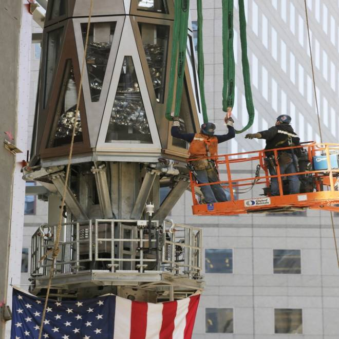 NYC's new look: One World Trade Center spire scrapes sky