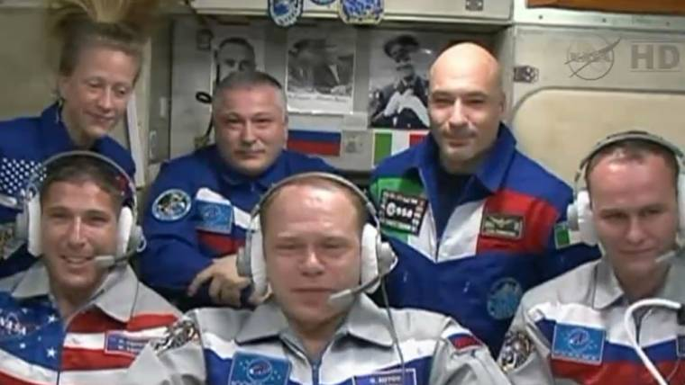 US-Russian trio reaches space station after 6-hour express ride