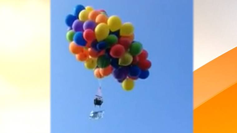 News & Man lofts into air in lawn chair with 101 helium balloons