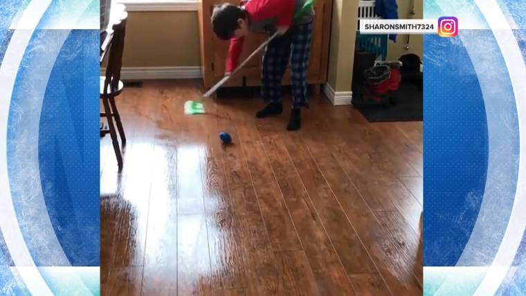 Watch This Young Olympics Fan Practice Curling With A Swiffer