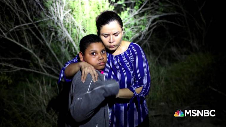 Terrified migrant mother holds her son as US Border Patrol stops them