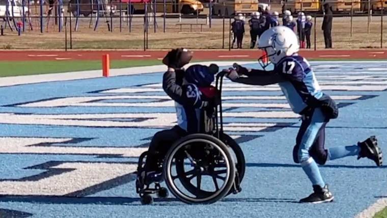 See the moment an 8-year-old with spina bifida scores a touchdown