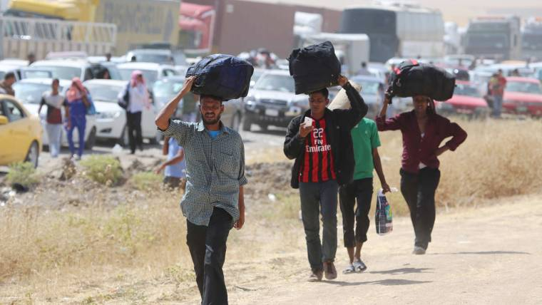 Iraqis Fleeing Violence in Mosul Seek Refuge in Irbil