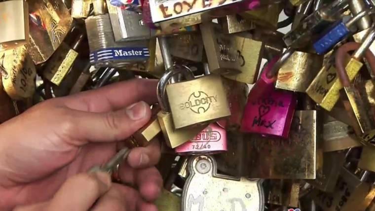 American Tackles Paris Love-Lock Bridge Tradition