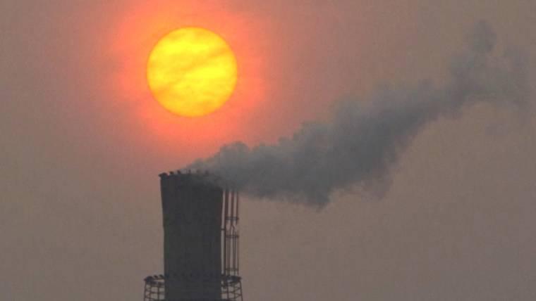 Top scientists urge cap on carbon emissions to limit climate change