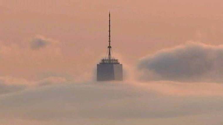 world trade center sits above the clouds
