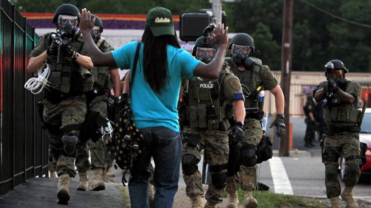 Blueprint for peace what ferguson can learn from cincinnati ferguson police criticized for military like response to riots malvernweather Choice Image